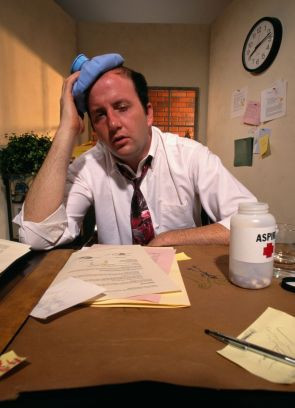...or you can put a hot water bottle on your head like this man who doesn't seem to understand how headaches work.